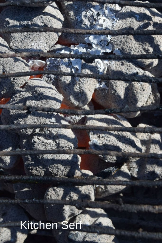 I put asparagus on a medium hot charcoal grill--to me that means the briquettes have turned white and I can see red coals. kitchenserf.com