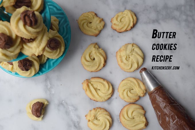 buttter cookies with tube of chocolate frosting