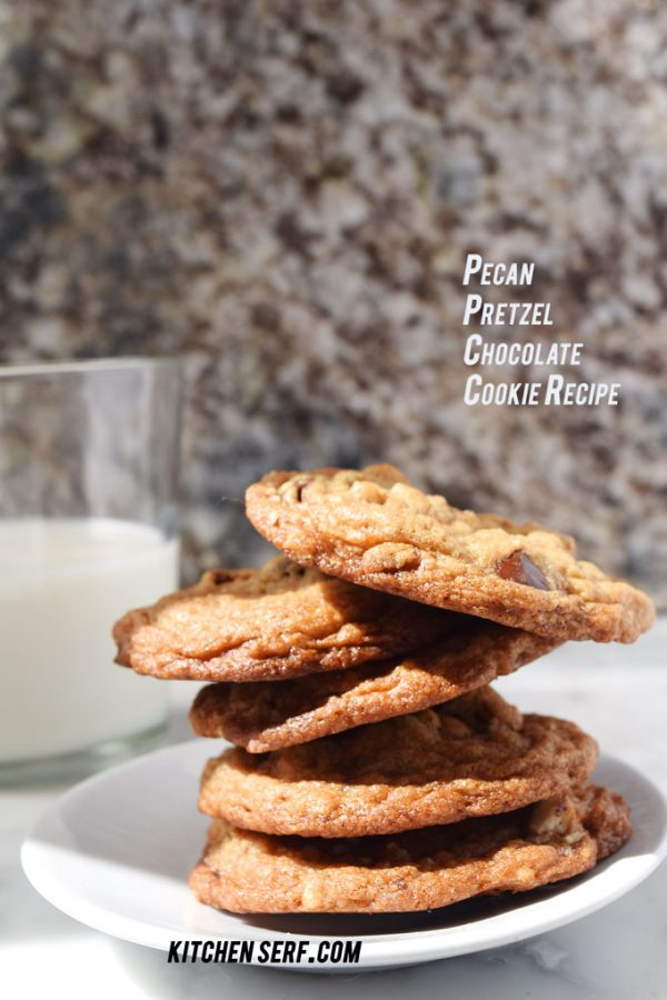 stack of cookies on plate with glass of milk
