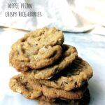 chewy toffee pecan crispy rice cookies on a granite countertop