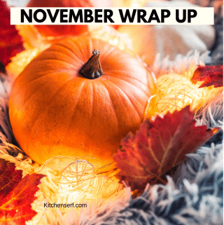 pumpkin and leaves on a fluffy grey blanket with lit up with a strand of little white lights