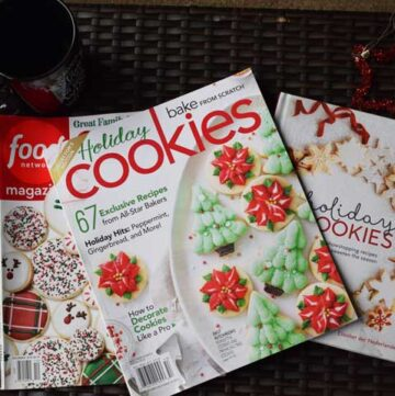 christmas cookie magazines on a brown ottoman