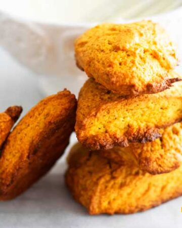 stack of small pumpkin scones on white background